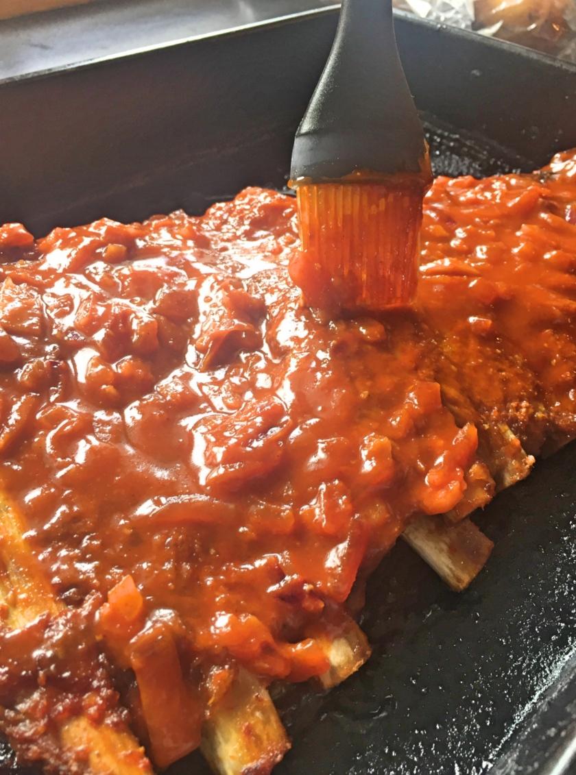 brushing bbq sauce